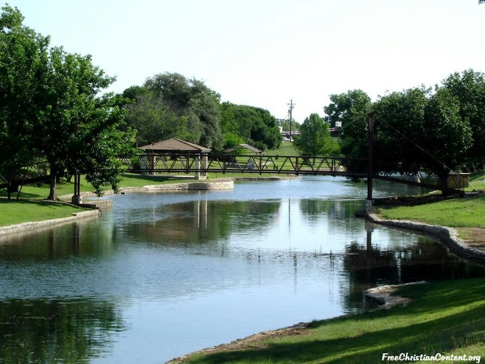 Park with a lake and bridge in Lampasas, TX